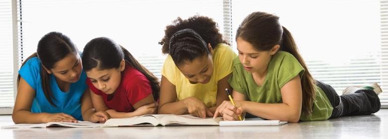 Girls doing schoolwork.
