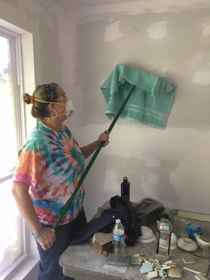 Cleaning the new sheetrock